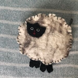 Fluffy sheep, wool, keys, cards and cash holder